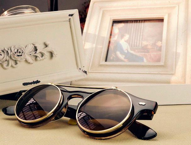 Круглые солнечные очки.